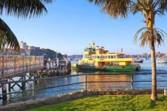 Home exchange in,Australia,NEUTRAL BAY,Ferry to city, passing between Sydney Opera House