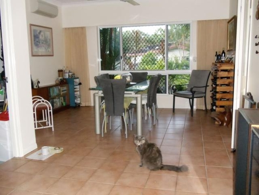 Home exchange in,Australia,CLIFTON BEACH,Dining room with Chloe our cat