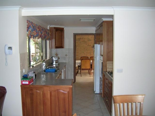 Home exchange in,Australia,FLAGSTAFF HILL,Galley kitchen looking into formal dining room