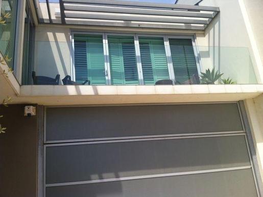 Home exchange in,Australia,GLENELG NORTH,Taken from downstairs in front of garage door look