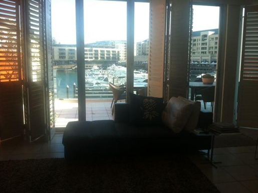 Home exchange in,Australia,GLENELG NORTH,Looking across from day bed to front deck and mari