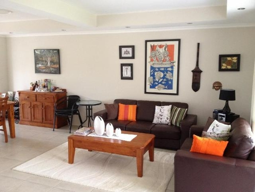 Home exchange in,Australia,URANGAN,Living Area with 3 seat and 2 seat lounges