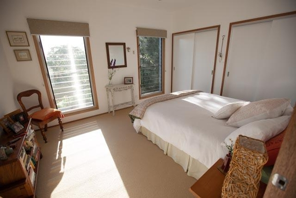 Home exchange in,Australia,BEXHILL,Queen size second bedroom with views down the vall