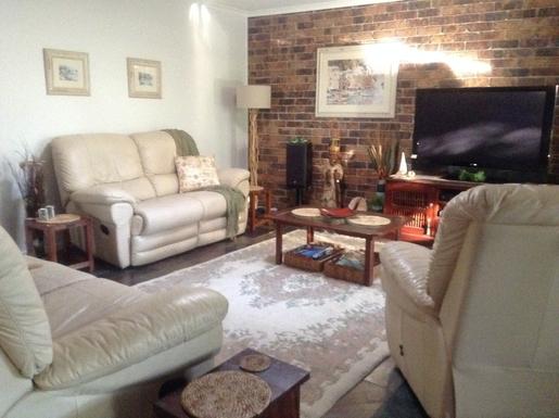 Home exchange in,Australia,Sunshine Coast,Main lounge room.