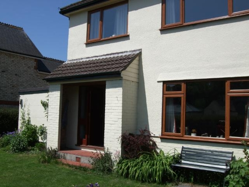Front of house with enclosed garden