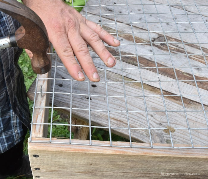 Making a compost sifter, attaching the wire screen to the frame