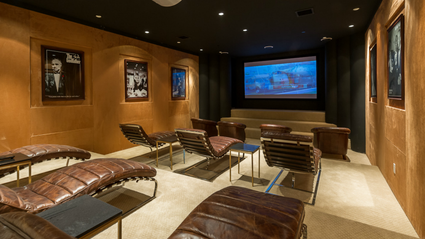 Gorgeous home theater with leather lounge chairs by Meridith Baer.