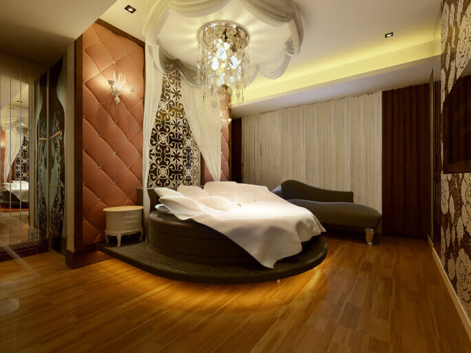 Elegant modern master bedroom design with wood floor and circular bed