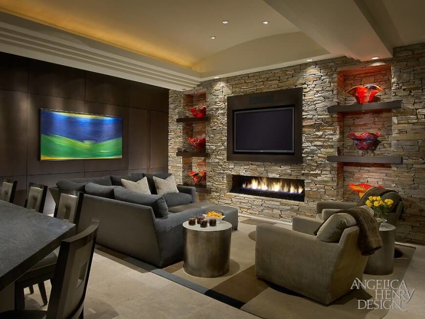 This Slim Gas Burning Fireplace Sits Neatly Below The Television In A Stone  Encasement.