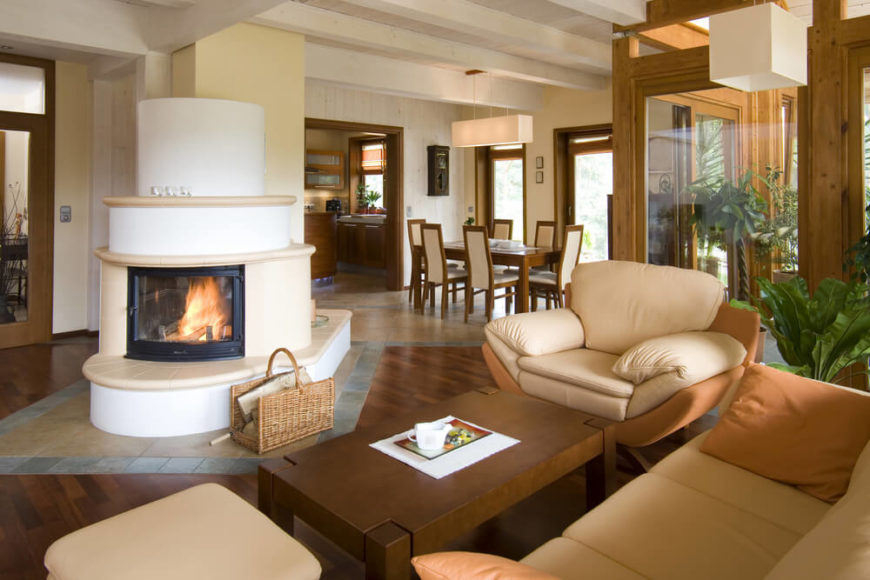 in an open concept space a dual sided fireplace is the perfect addition - Decorating Ideas For Living Rooms With Fireplaces