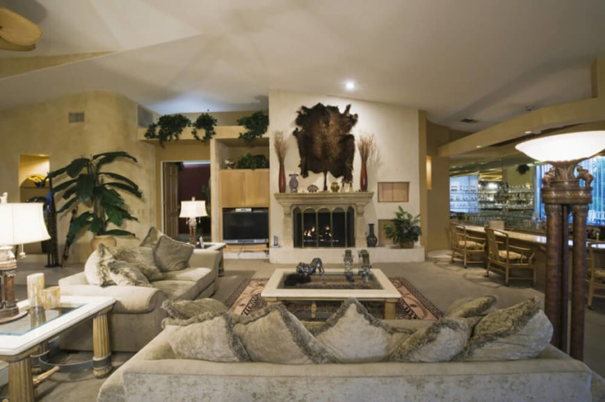 Animal hides are another way to decorate the walls, but they should be used sparingly, as to not overwhelm the room.