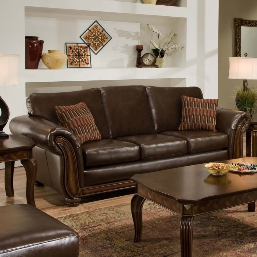 A Sleek Brown Leather Sofa With Accent Pillows When Paired Dark Wooden Tables
