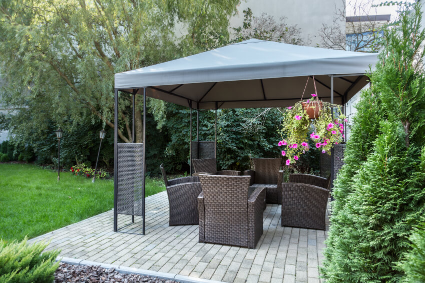 A lovely aluminum gazebo with a canvas canopy. The gazebo is placed over a brick : patio gazebos and canopies - memphite.com