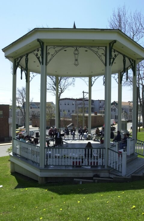 While this gazebo is a public structure, and isn't in a backyard, it is a great example of how large gazebos can be. This one is being used as a private concert venue.