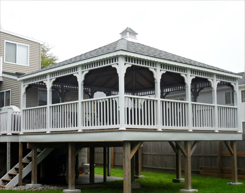 While most gazebos are away from the home, this one is elevated to the same level as the deck and serves as a massive covered patio for entertaining and dining.