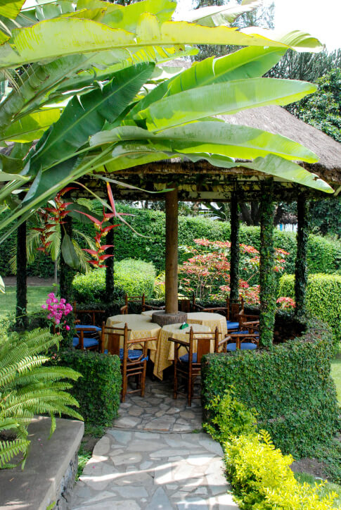 A straw-topped gazebo has a uniquely tropical atmosphere and is perfect for tropical themed yards or even resorts.