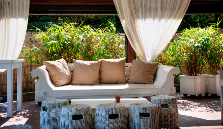 Bamboo planted in containers is a great way to create a privacy shade for an open gazebo.