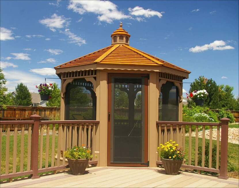 This screened gazebo is built off the corner of the main deck and patio  area and - 110 Gazebo Designs & Ideas - Wood, Vinyl, Octagon, Rectangle And More