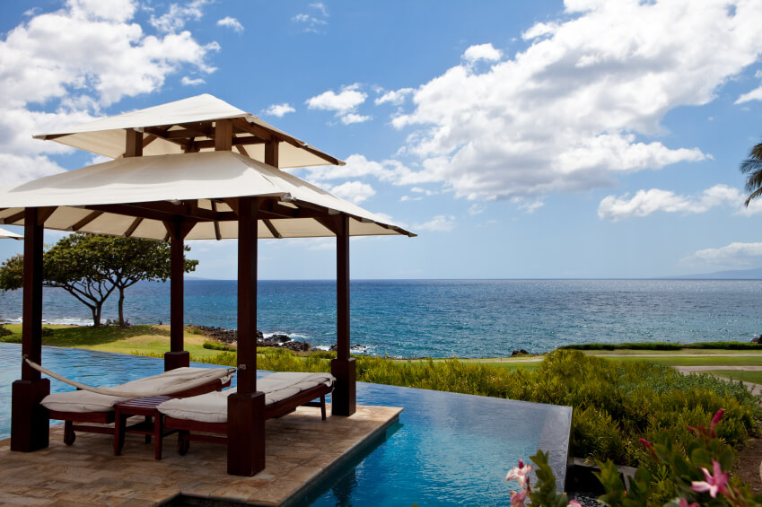 Canopy gazebos can be tiered as well. This one looks out over an incredible infinity pool, and further on out, over the coast.