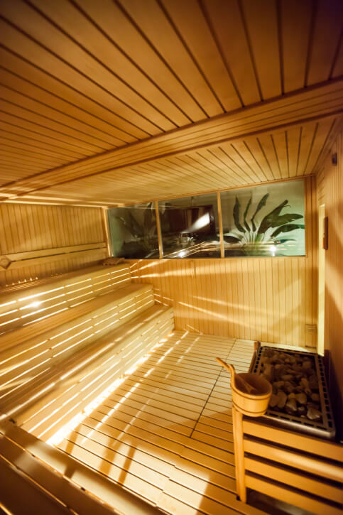 Another sauna example of a three-level bench set up. This sauna also has larger than average windows.