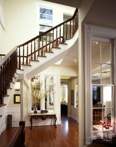 Entrance way framed by staircase wrapping around the space.