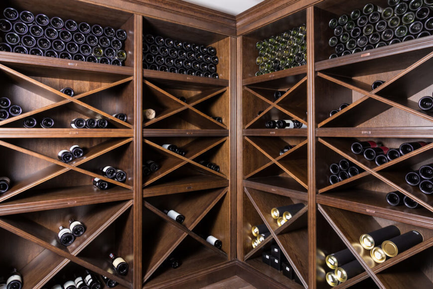 Close-up of custom wood wine cabinets designed for storing maximum number of bottles.