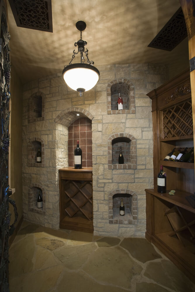 Example of an effective brick wall design that incorporates wine storing for a basement or home bar area. This wine-storing room is complemented with a built-in wood wine cabinet.