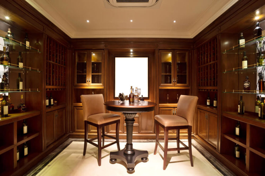 Custom wine storage cabinets form the walls of this wine tasting room with an intimate table for two for fine wine tasting.