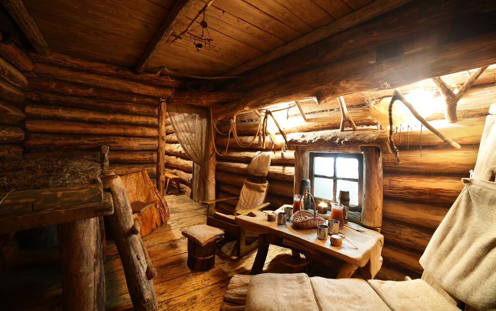 Traditional sauna hut with table and chairs.