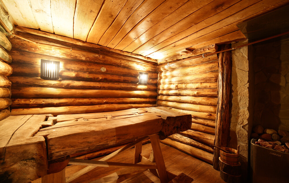 Traditional Dry Heat Sauna In Log Hut With Fold Down Bench