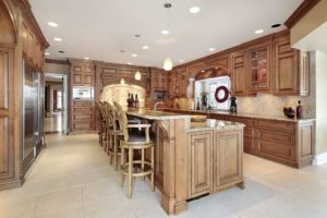 Luxury custom all wood kitchen with large 2-tiered island