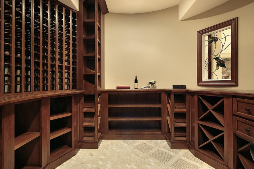 Example of a small space turned into elegant wine cellar with dark custom wood wine storing cabinets.