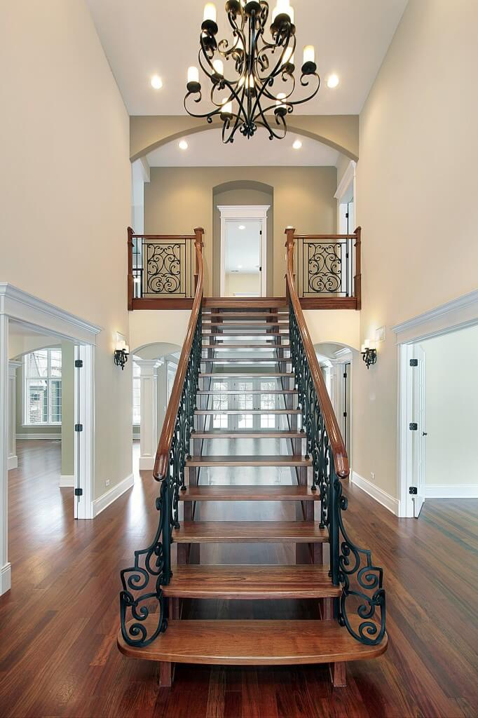 "Open foyer with straight staircase descending from small upper landing. Unfortunately the home is empty so we don't get to see the full effect with furniture and that ""lived in"" look."