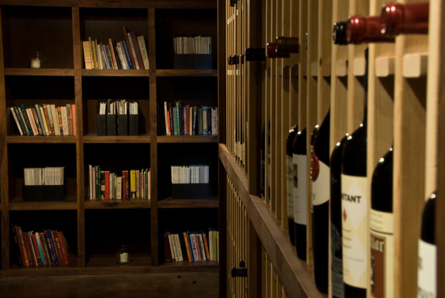 Interesting shelving unit combines books and wine.