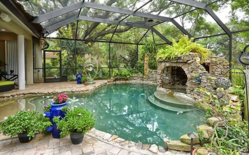 Glass Covered Pool, Hot Tub, Patio And Gardens Extending Directly Off The  Home