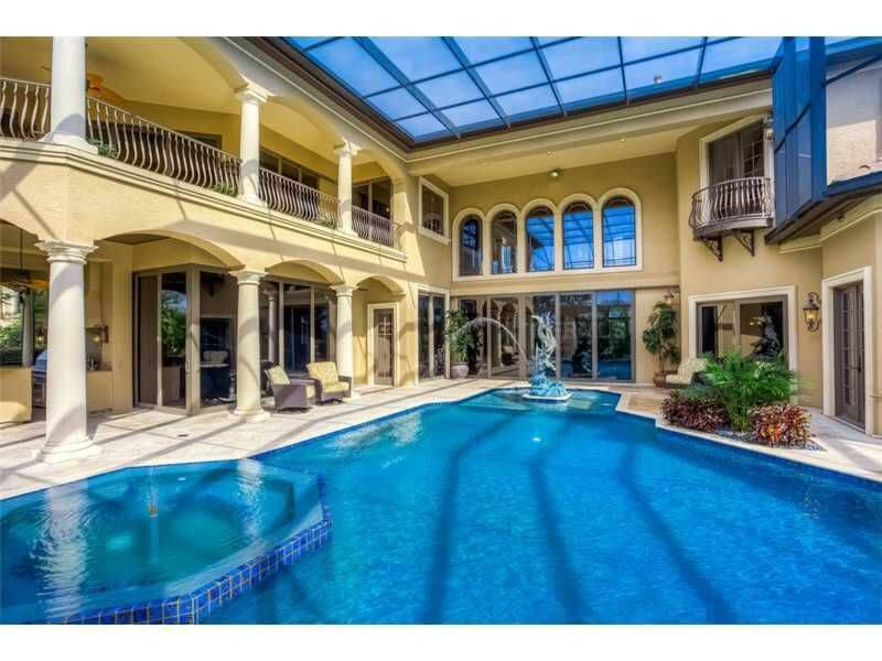 u shaped mansion with glass covered pool in the courtyard glass covering makes