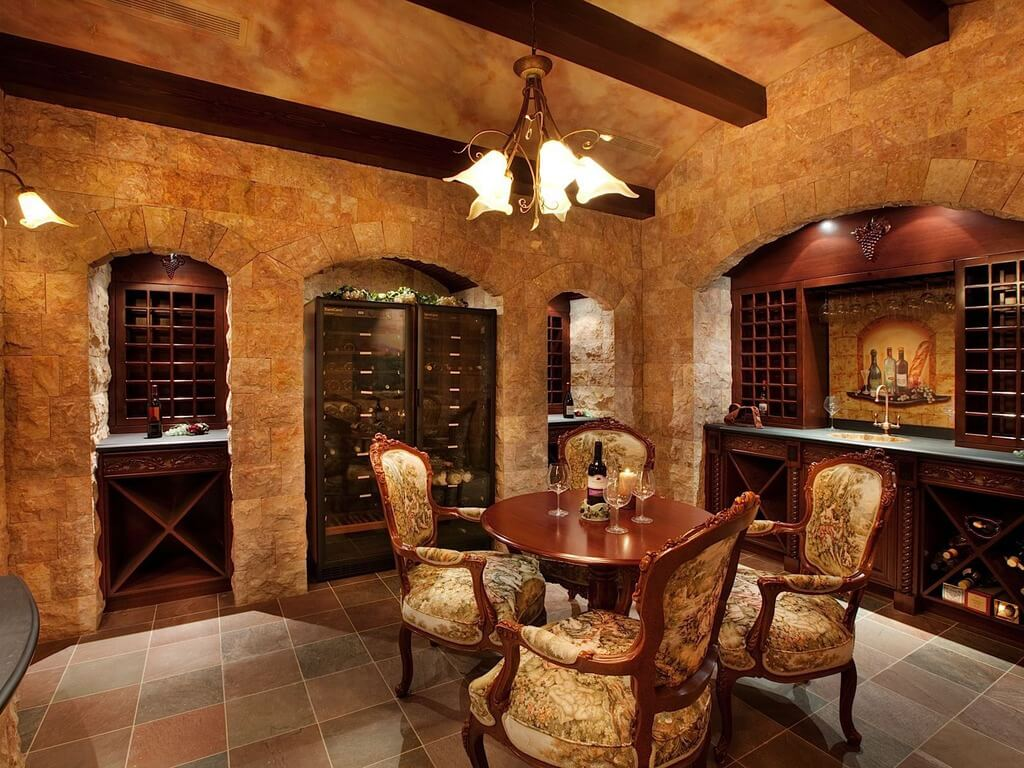 Luxurious brick and wood wine cellar and tasting room in a cave-like design. Tasting area accommodates four people.