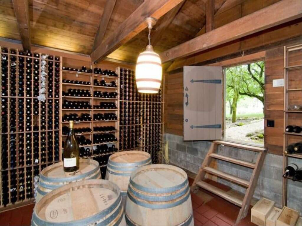 The notable feature of this wine cellar is the access door to the outside which is a loading door for delivering wine.