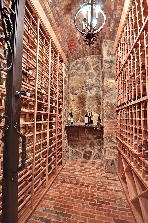 Stone, brick and wood cabinet wine cellar.