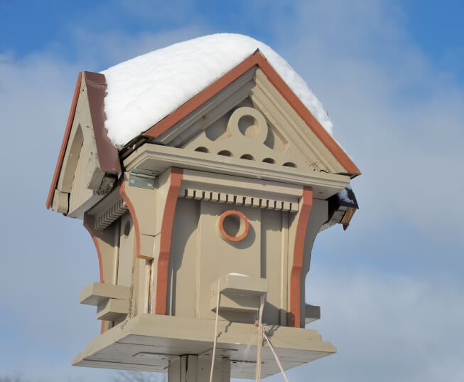 Elaborately designed 4-sided wooden bird house.