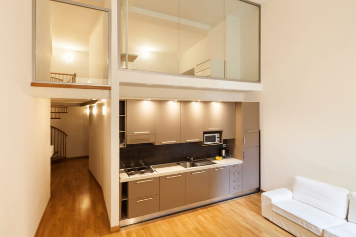 Tiny apartment with glassed-in loft above the kitchen and entry hall.