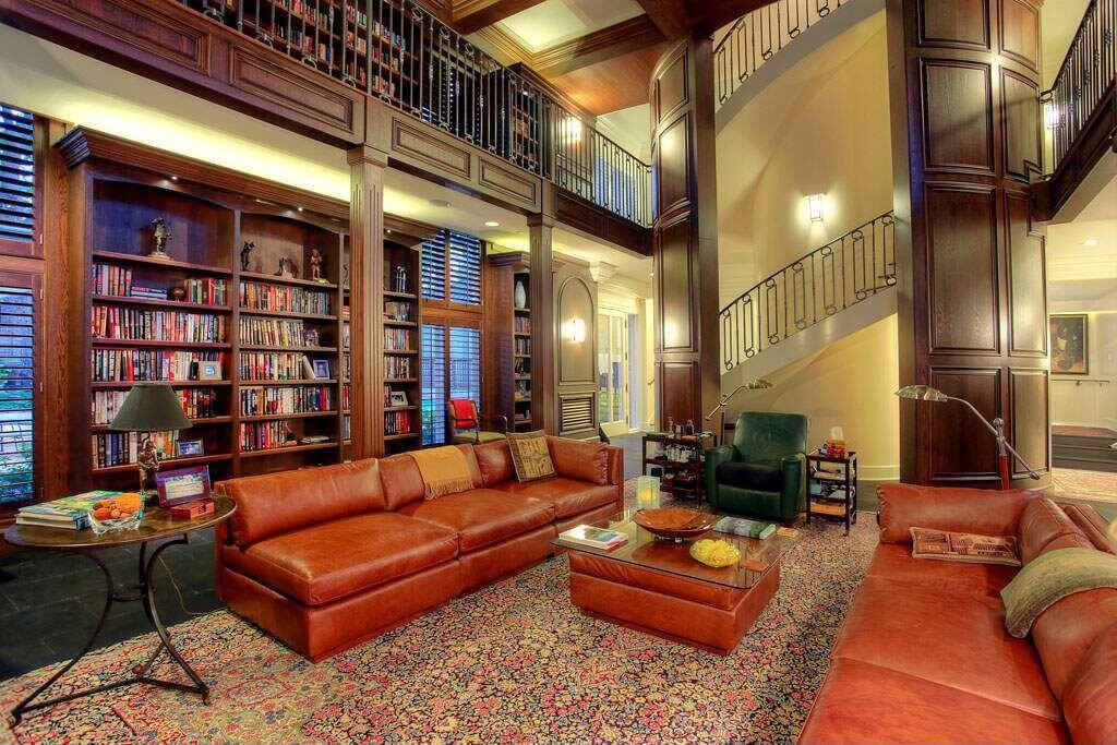 Massive Living Room And Library Combination Where The Library Is Situated  On The Main Floor And
