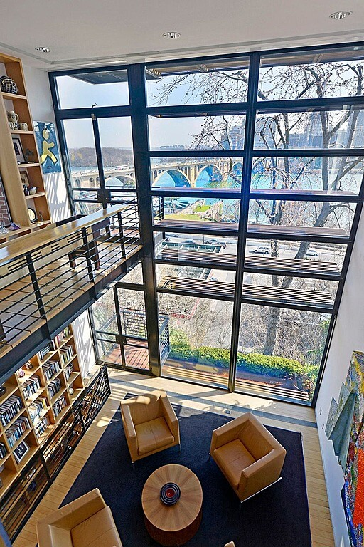 Modern home with library loft looking out a two story window