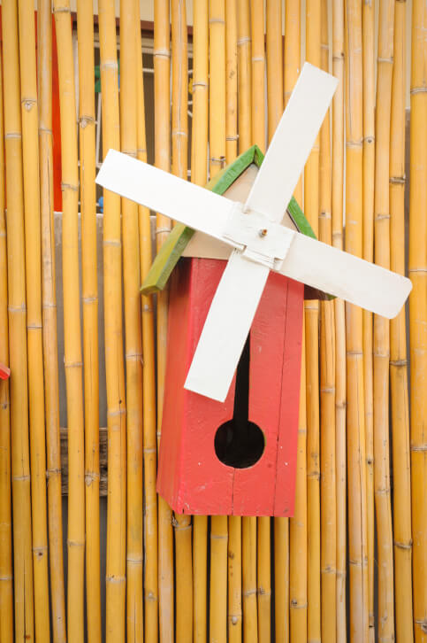 Windmill style bird house. Here's a simple bird house design that looks like a simple windmill.