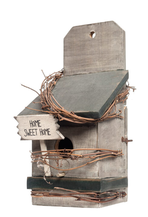 Box-style bird house with sloped roof designed to attach to a flat surface such as a fence or the side of a house.
