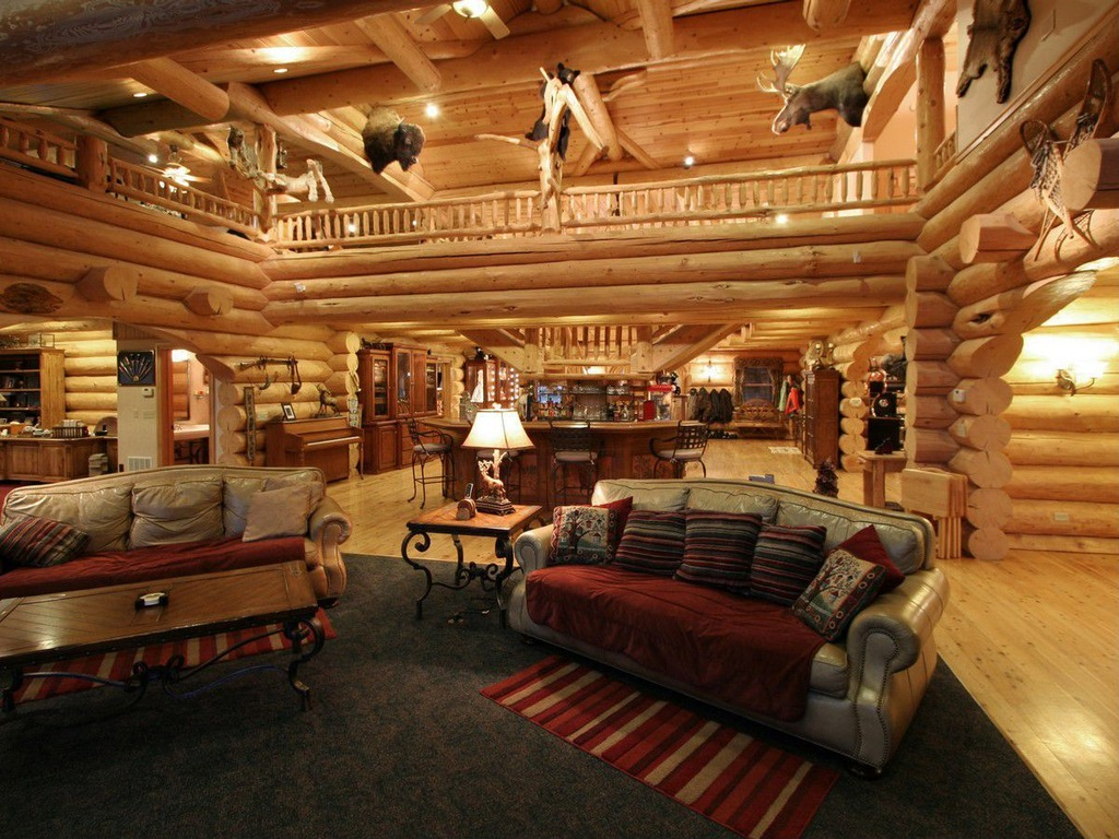 lofty design decorating ideas for living rooms. The massive log home above features a large  but unobtrusive loft room Lofty Loft Room Designs