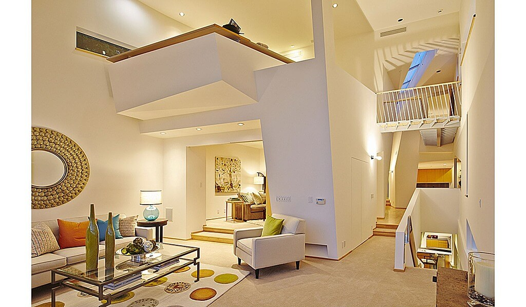 Intricate loft system where the loft space sits like a tray straddling two rooms on the main floor