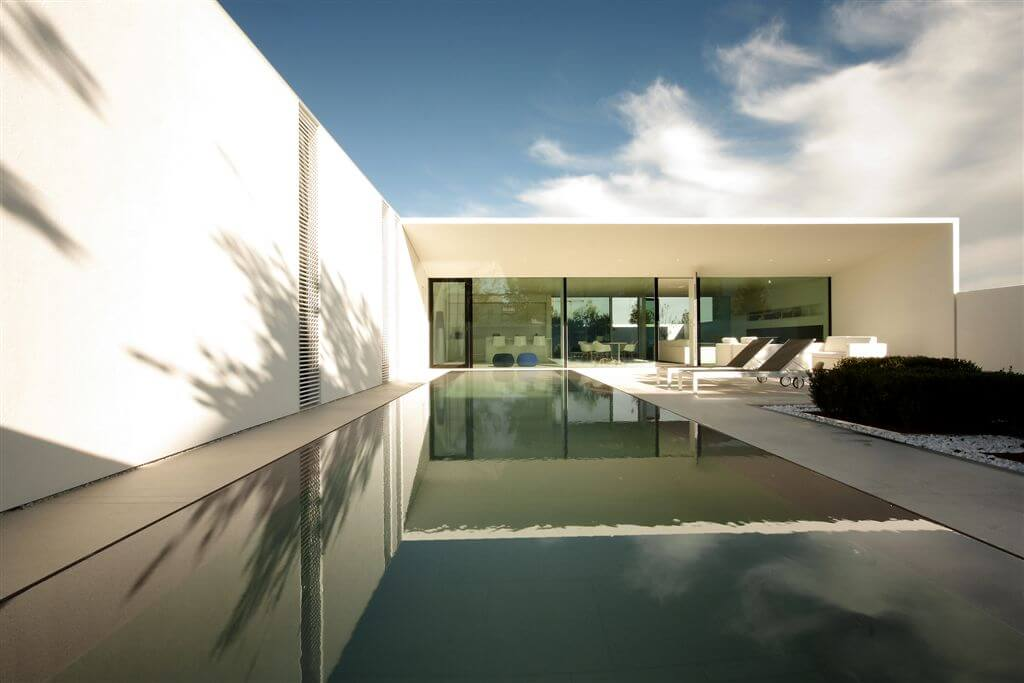Here's the opposite view of the pool area, with floor to ceiling windows extending the length of the home.