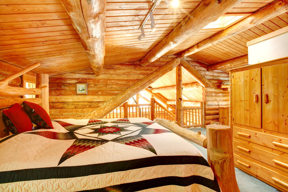 Loft bedroom that actually has a good amount of privacy in log home