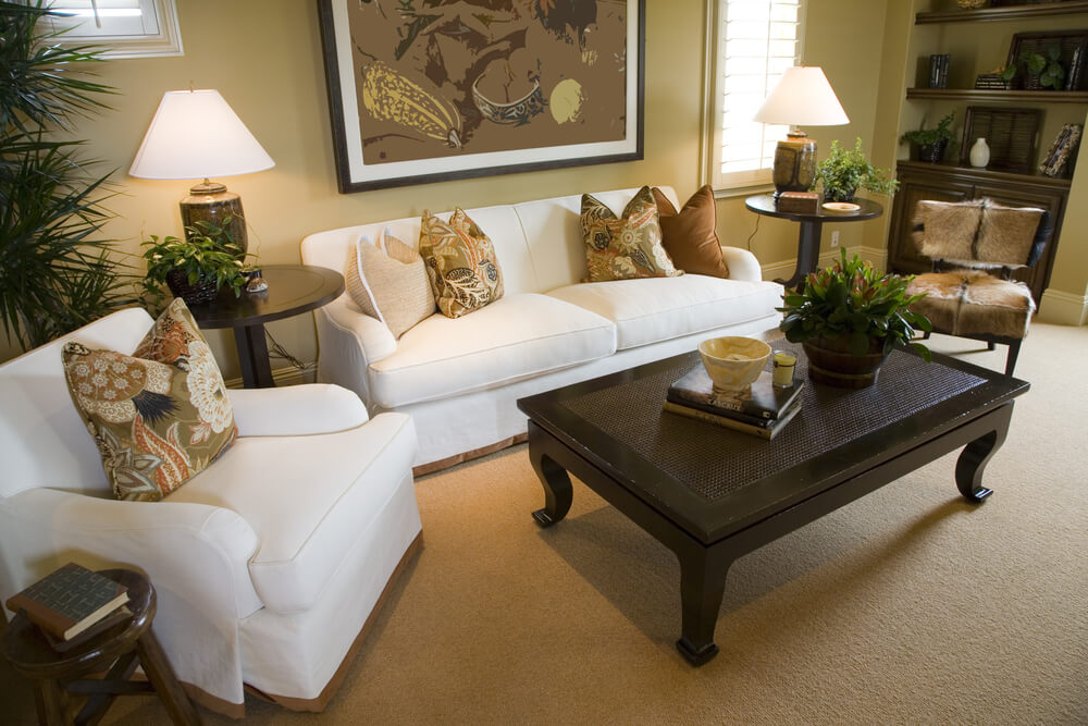 Simple Living Room With One Small White Sofa, One White Armchair And One  Armless Antique